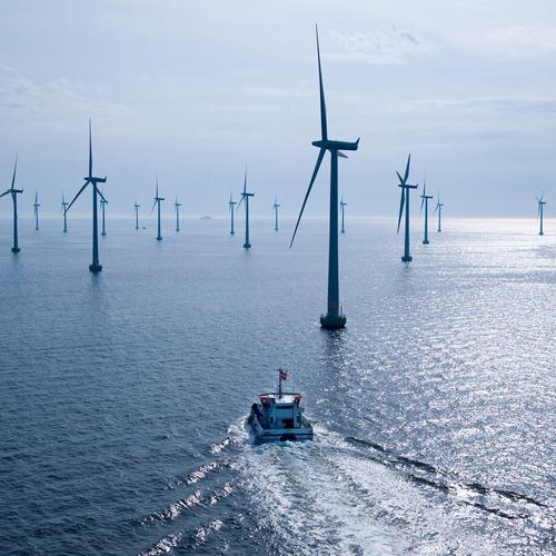 Wind turbines on the sea wallpaper
