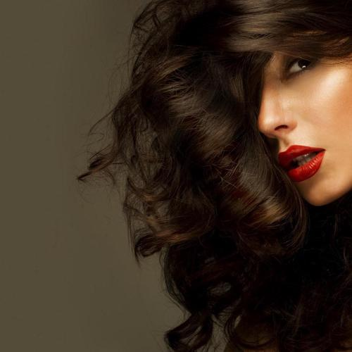 Woman Red Lips and curvy hair