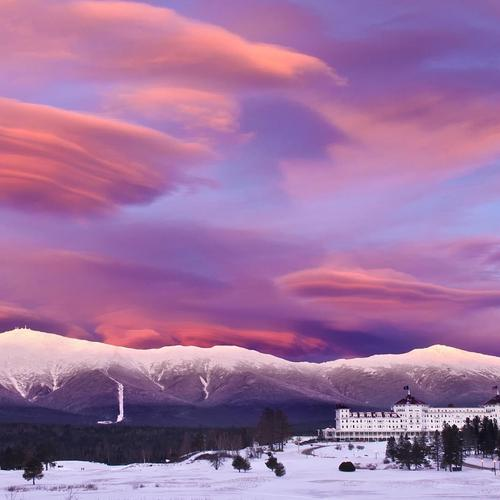Wondrous purple clouds over winter resort hotel