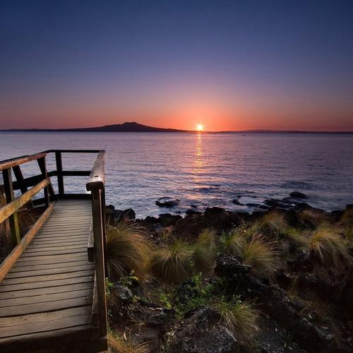 Wooden walkway in subrise - Auckland wallpaper