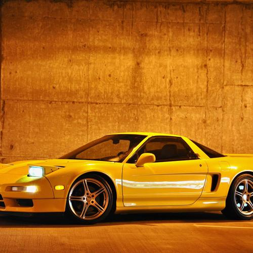 Yellow sport car in tunnel