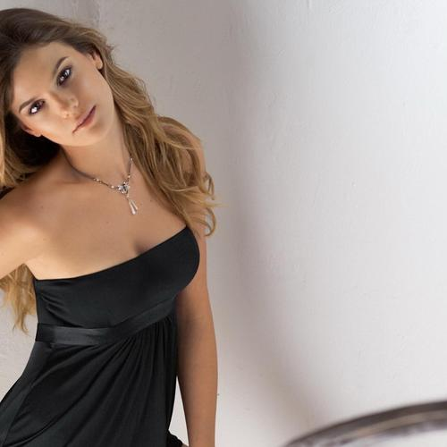 Yesica Toscanini in black dress
